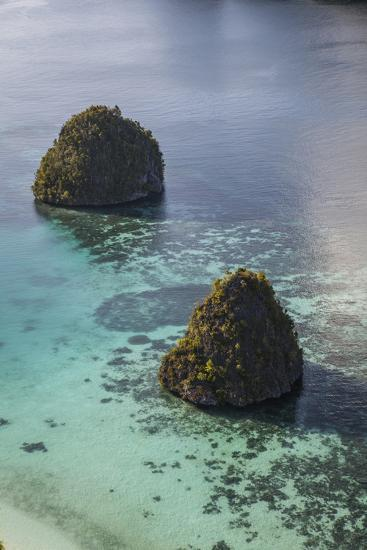 Limestone Islands Surrounded by a Coral Reef in Raja Ampat-Stocktrek Images-Photographic Print