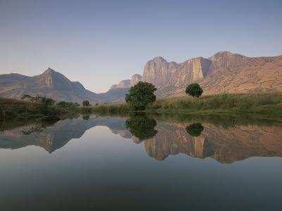 Limestone Rock Formations are Reflected in Still Waters-Michael Melford-Photographic Print