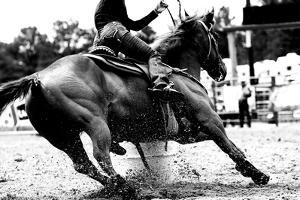 High Contrast, Black and White Closeup of a Rodeo Barrel Racer Making a Turn at One of the Barrels by Lincoln Rogers