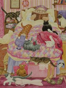Grandma and 10 cats in the bedroom by Linda Benton
