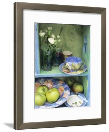 Coffee Cup, Flowers and Bowl of Apples on Shelves