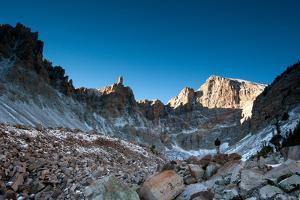 A Hiker Stands Below Wheeler Peak In Great Basin National Park, Nevada by Lindsay Daniels