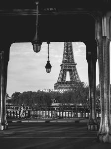 A Woman Walks Down A Paris Street With The Eiffel Tower In The Background by Lindsay Daniels