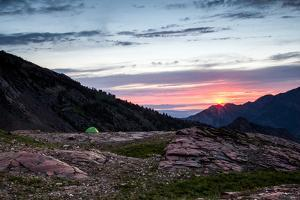 Green Tent With Dramatic Landscape During Sunset In Big Cottonwood Canyon, Utah by Lindsay Daniels
