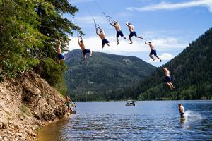 Man Jumps From A Rope Swing At Smith And Morehouse Reservoir, Utah Series by Lindsay Daniels