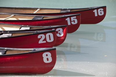 Numbered Canoes On Lake Louise