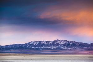 Orange Clouds Over The Promontory Mountains In Northern Utah by Lindsay Daniels