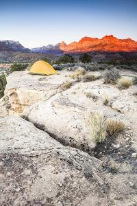 Yellow Tent And The Sun Setting On The Mountain Cliffs In The Background by Lindsay Daniels