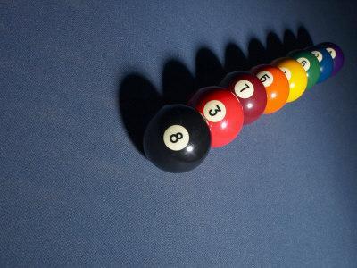 Line Of Billiard Balls On Blue Felt Pool Table