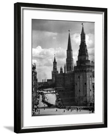 Line of Russians Along Street in Front of the Kremlin-Margaret Bourke-White-Framed Photographic Print