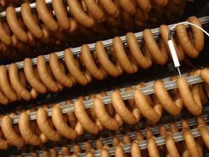 Links of Sausage Hanging on Drying Racks