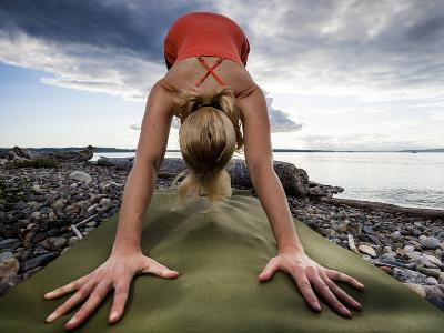 Lisa Eaton Holds a Downward Dog Yoga Pose on the Beach of Lincoln Park - West Seattle, Washington-Dan Holz-Photographic Print