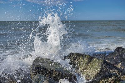 Waves crashing on rocks, Honeymoon Island State Park, Dunedin, Florida, USA