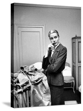 Actress Grace Kelly Packing Clothing Prior to Her Wedding to Prince Rainier