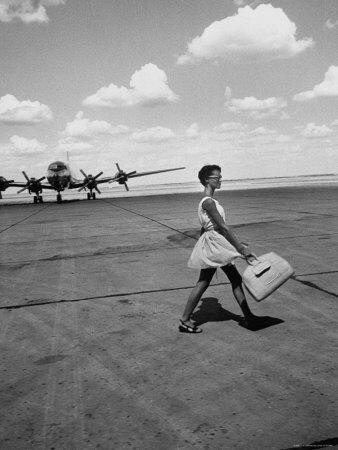 American Airline Hostess Crossing Field on Way to Jobs as a Model and Sales Clerk at Neiman Marcus