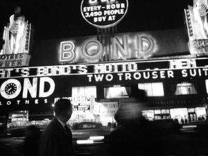 Bright Neon Lights of Bond's Clothing Store by Lisa Larsen