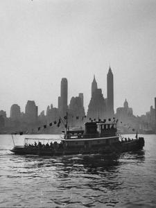 Excursion Party Tugboat with City Skyline in the Background by Lisa Larsen