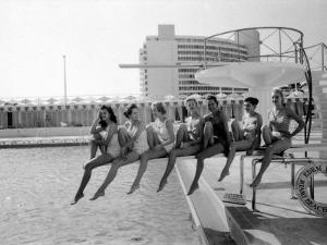 Fashion Models Wearing Swimsuits at the Eden Roc Swimming Pool by Lisa Larsen