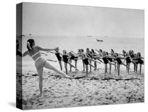Girls of the Children's School of Modern Dancing, Rehearsing on the Beach by Lisa Larsen