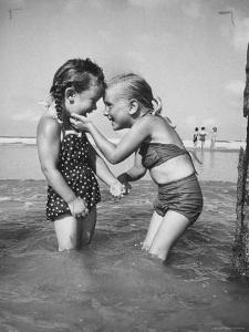 Little Girls Playing Together on a Beach by Lisa Larsen