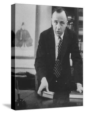 Physicist John A. Wheeler Attending a Meeting