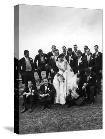 Sen. John F. Kennedy and His Bride Jacqueline Posing with 14 Ushers from Their Wedding Party