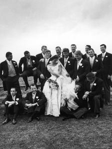 Sen. John F. Kennedy and His Bride Jacqueline Posing with 14 Ushers from Their Wedding Party by Lisa Larsen