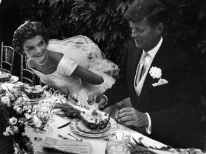 Senator John F. Kennedy and Bride Jacqueline Enjoying Dinner at Their Outdoor Wedding Celebration by Lisa Larsen