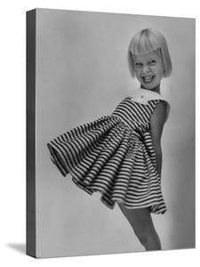 Very Cute Young Model Wearing a Dress by Lisa Larsen