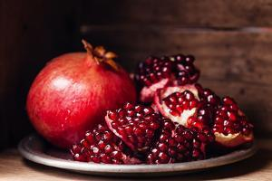 Pieces and Grains of Ripe Pomegranate by Lisovskaya Natalia