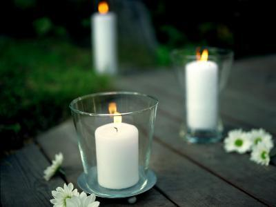 Lit Candles in Glass Candleholders--Photographic Print