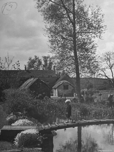 Little Boy Crossing the Bridge over the Stream at Winson Mill Farm, A War Nursery-Hans Wild-Photographic Print