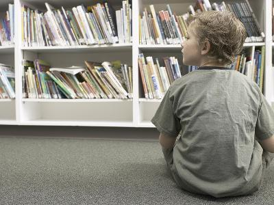 Little Boy Looking Rows of Books on Library Shelves--Photographic Print