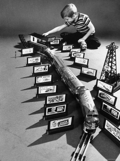 Little Boy Playing with a Toy Train and Billboard Set-Walter Sanders-Photographic Print