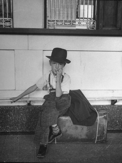 Little Boy Sitting on His Luggage While Waiting For the Train at the Denver Union Station-Sam Shere-Photographic Print