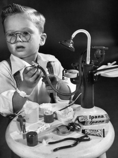 Little Boy with a Toy Dentist Set-Walter Sanders-Photographic Print