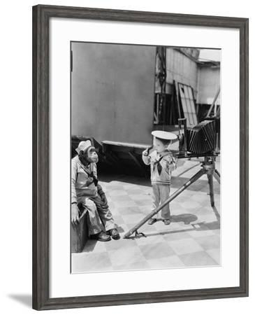 Little Boy with Chimpanzee Taking Pictures--Framed Photo