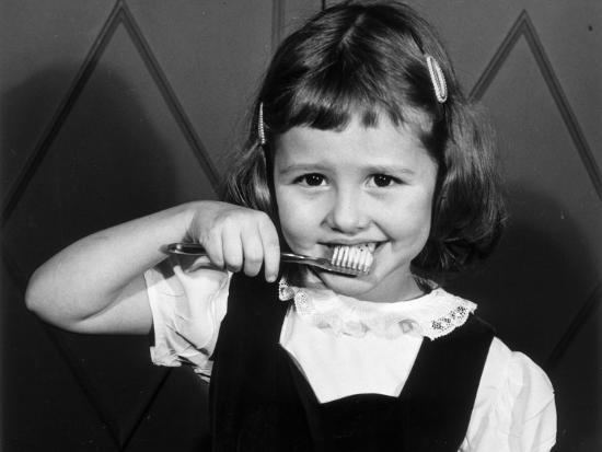 Little Girl Brushing Her Teeth-George Marks-Photographic Print