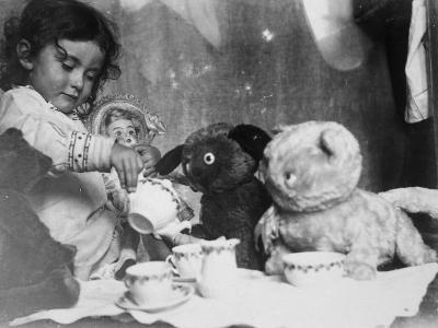 Little Girl Hosts a Tea Party, Three Bears and a Doll Attend--Photographic Print
