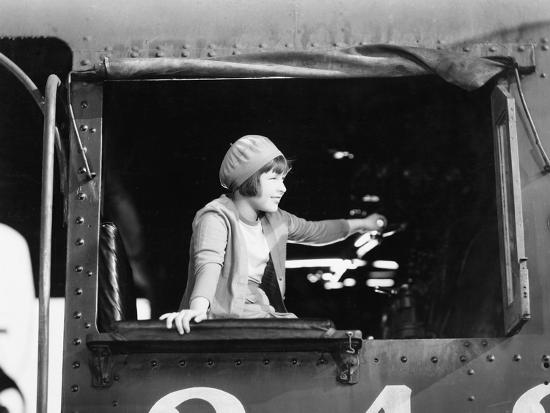 Little Girl in a Beret Driving a Train--Photo