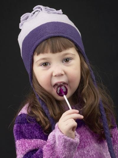 Little Girl in Toque with Lollipop--Photographic Print