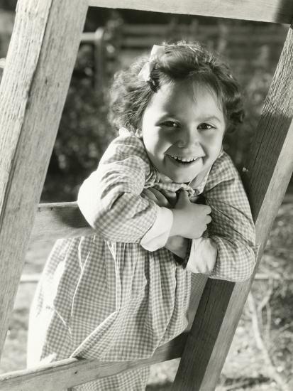 Little Girl Leaning on Ladder--Photo