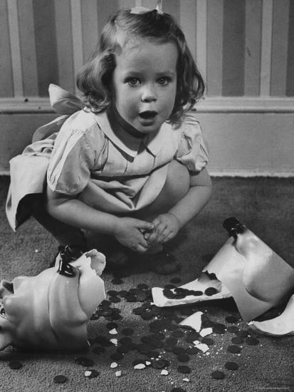Little Girl Leaning over Her Broken Piggy Bank-Nina Leen-Photographic Print