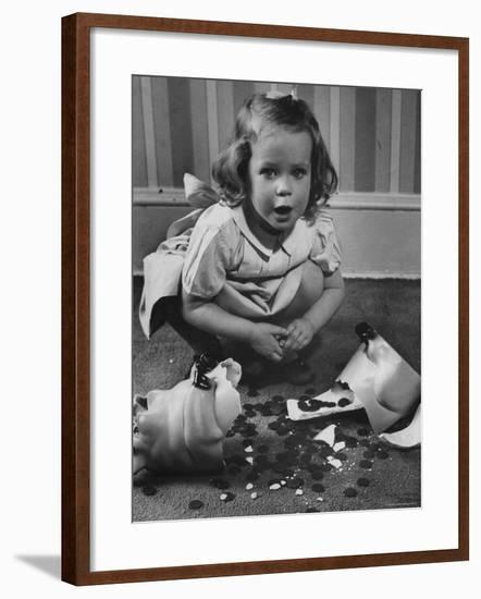 Little Girl Leaning over Her Broken Piggy Bank-Nina Leen-Framed Photographic Print