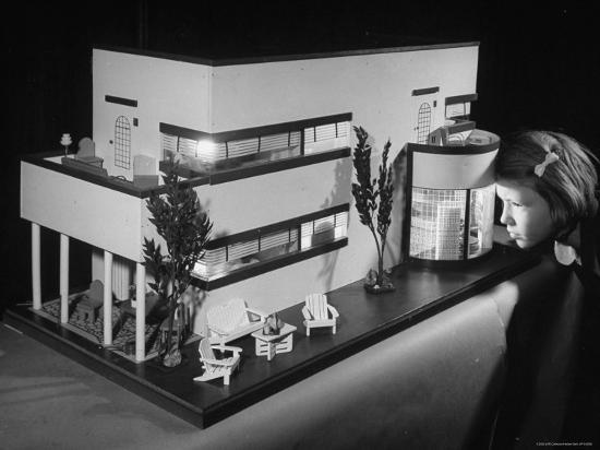 Little Girl Looking Into a Modern Doll House Being Sold at F.A.O. Schwarz-Herbert Gehr-Photographic Print