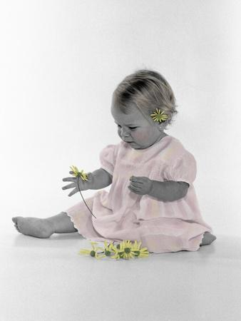 https://imgc.artprintimages.com/img/print/little-girl-sitting-with-flower-tucked-behind-her-ear_u-l-pynk9z0.jpg?p=0