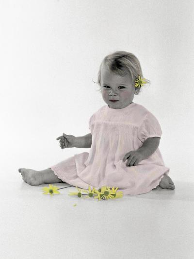 Little Girl Sitting with Flower Tucked Behind Her Ear-Nora Hernandez-Giclee Print