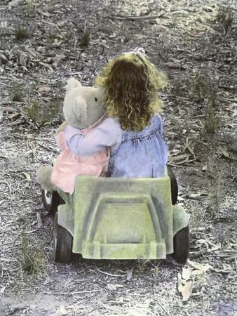 https://imgc.artprintimages.com/img/print/little-girl-with-her-teddy-bear-riding-in-a-toy-car_u-l-pynylp0.jpg?p=0