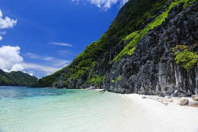 Little White Sand Beach in the Clear Waters of the Bacuit Archipelago, Palawan, Philippines-Michael Runkel-Photographic Print