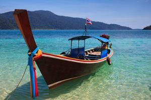 Long Tail Boat Sit On The Beach Rawi Island Thailand by lkunl